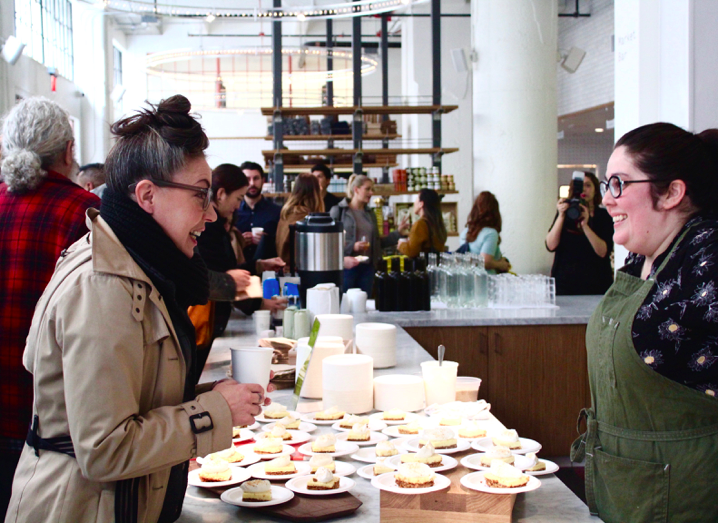 Atmosphere of attendees enjoying Fiona Chef Nicole Rucker's beloved Key Lime Pie at the The Manufactory LA.